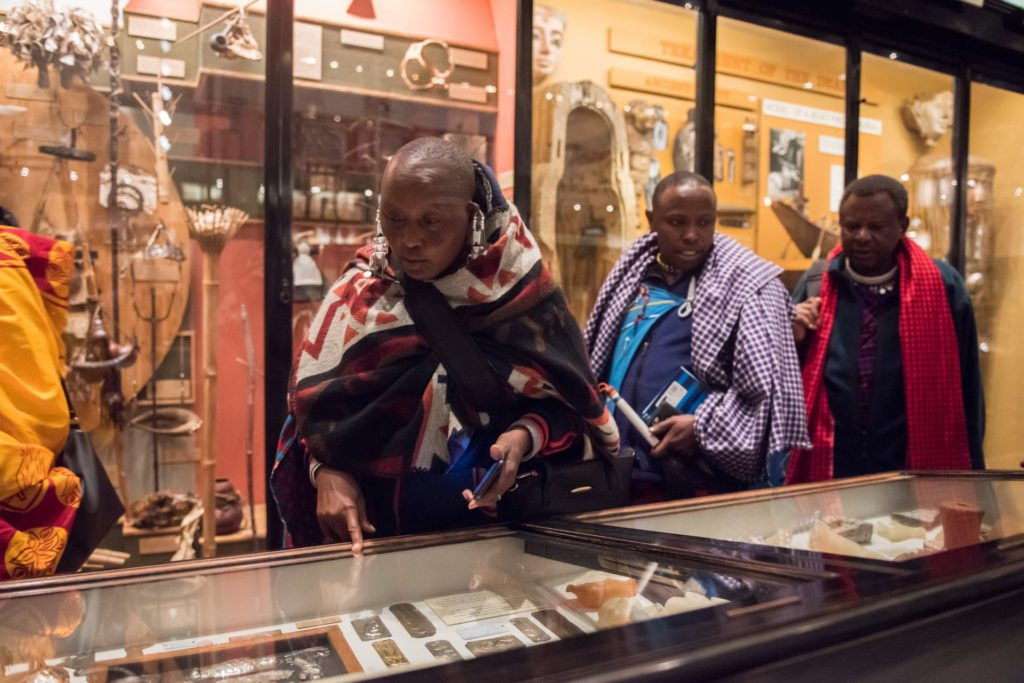 The collection is inspected by Kuweya Timan Molle, Samwel Nangiria and Francis Shomet Ole Naingisa. Photo by John Cairns.