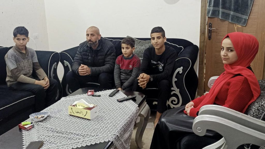 Sami Gharqud and his older children in Qalqiliyah. Photo by Olfat Al-Qurd, B'tselem.